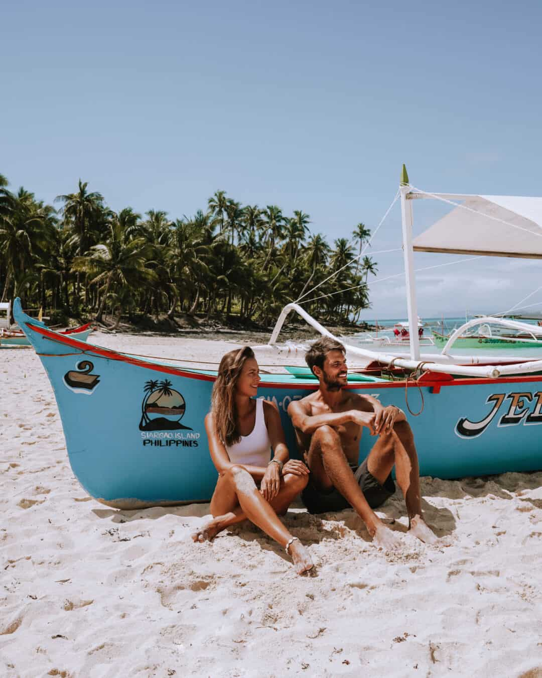 Siargao Daku Island Beach Boat Couple Sitting