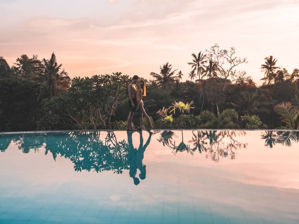 Couple on the pool at sunset at amatara royal ganesha hotel