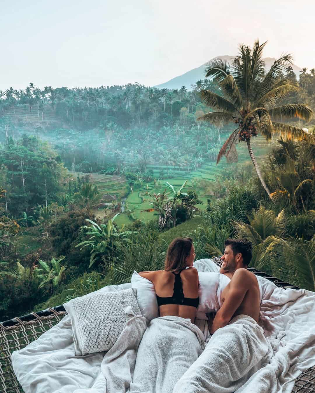 Couple chilling in net at Camaya Bali Bamboo House