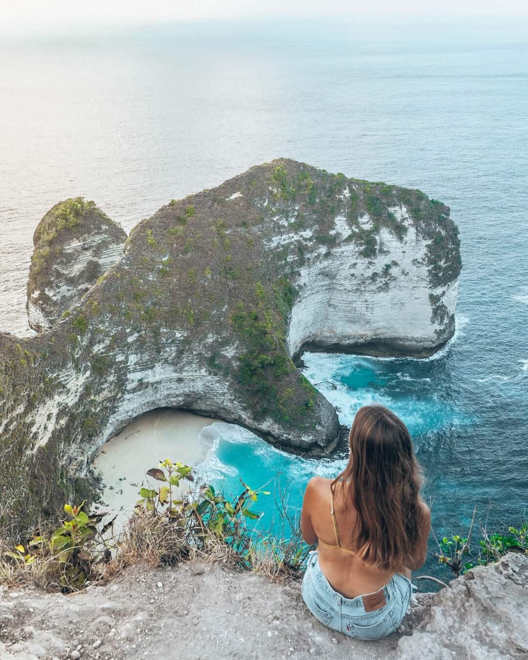 Women sitting on the cliff of Kelinking Beach Nusa Penida