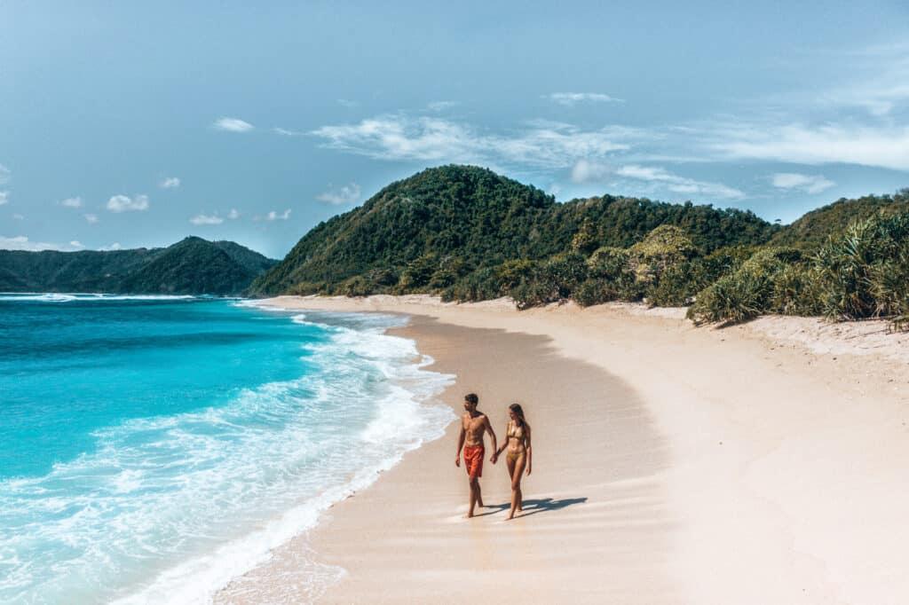 Drone shot of couple walking on Mawi Beach Lombok