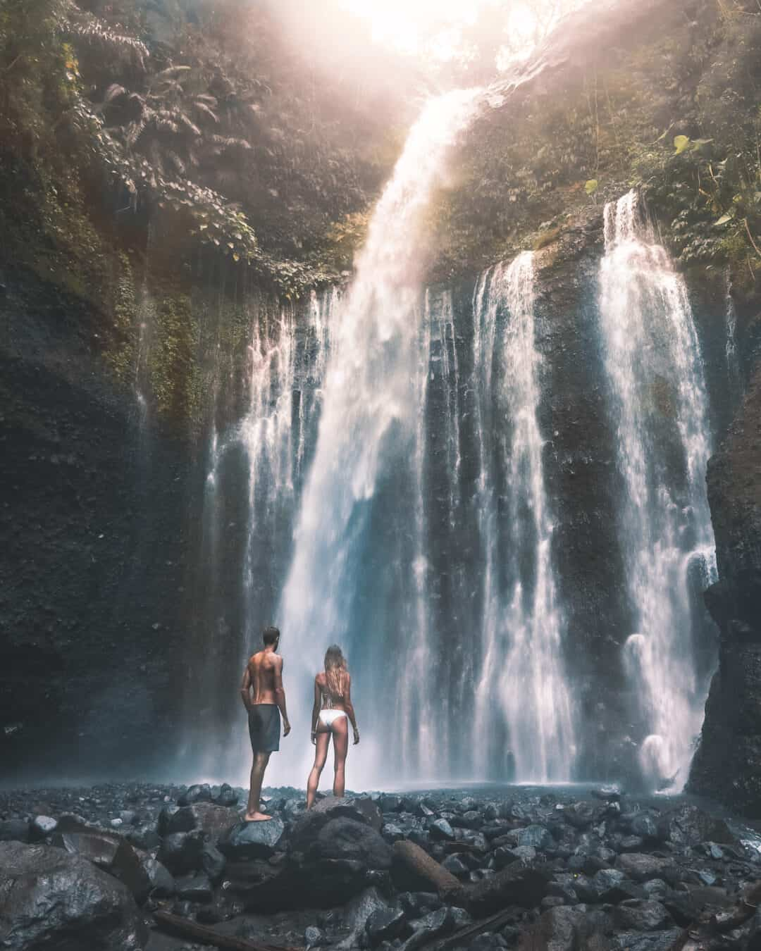Couple in front of Tiu Kelep Waterfall Lombok