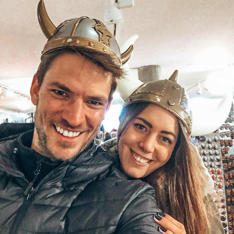 Two people with viking helmets in souvenir shop Iceland