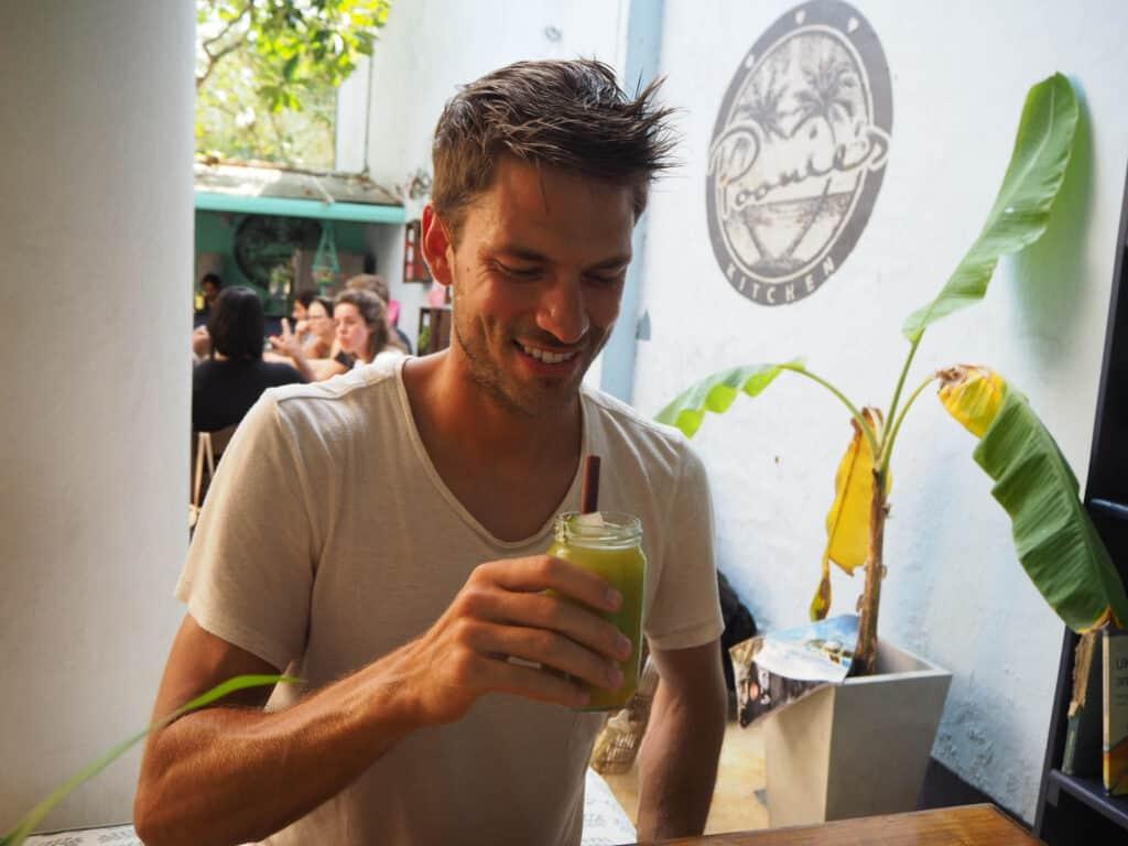Galle Fort Poonies Kitchen Restaurant Man drinking