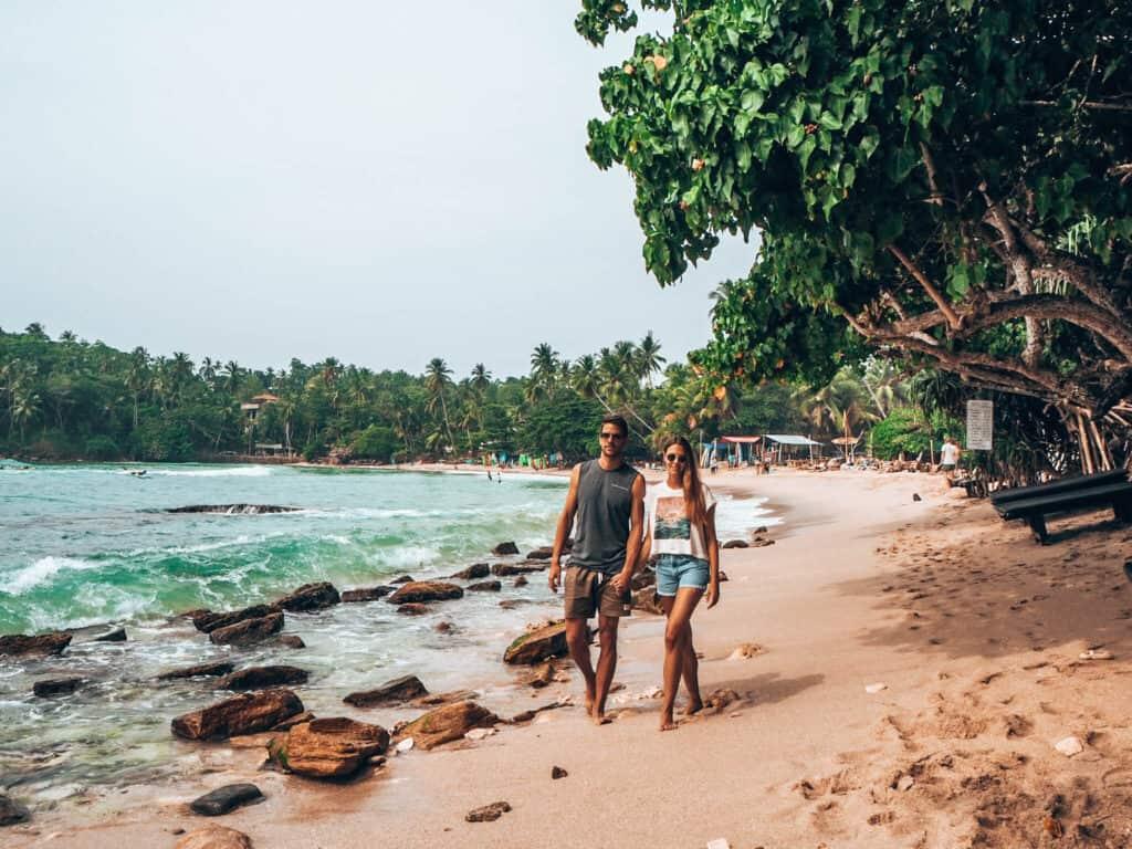 Hiriketiya Beach couple walking on beach